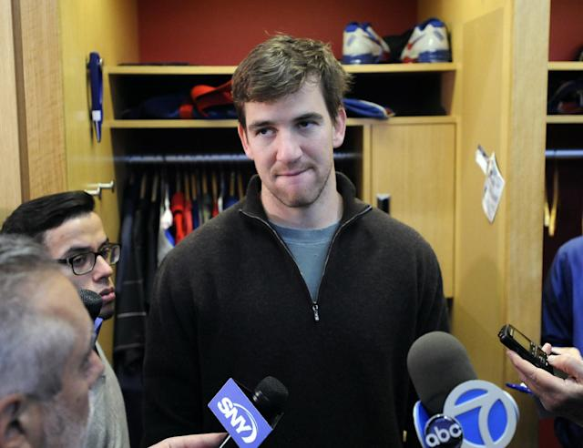 New York Giants quarterback Eli Manning speaks to the media Monday, Dec. 30, 2013, in East Rutherford, N.J. after the Giants season ended with a 7-9 record. (AP Photo/Bill Kostroun)