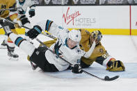 San Jose Sharks center Ryan Donato (16) attempts a shot on Vegas Golden Knights goaltender Marc-Andre Fleury (29) during the third period of an NHL hockey game Wednesday, April 21, 2021, in Las Vegas. (AP Photo/John Locher)