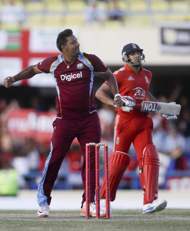 West Indies' Ravi Rampaul, left, celebrates next to England's Ravi Bopara at the end of their first one-day international cricket match at the Sir Vivian Richards Cricket Ground in St. John's, Antigua, Friday, Feb. 28, 2014. West Indies won 269/6 to 254/5. (AP Photo/Ricardo Mazalan)