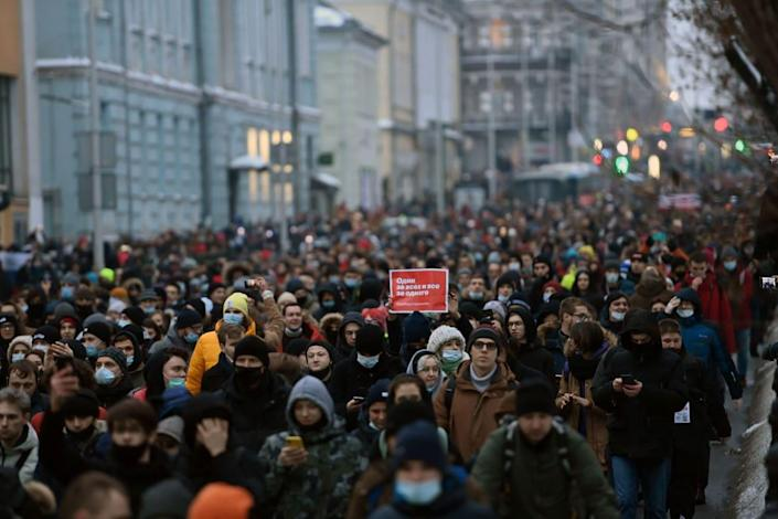 """<div class=""""inline-image__title"""">1230744031</div> <div class=""""inline-image__caption""""><p>""""Protesters march in support of jailed opposition leader Alexei Navalny in downtown Moscow on January 23, 2021. The placard reads """"One for all and all for one"""". - Navalny, 44, was detained last Sunday upon returning to Moscow after five months in Germany recovering from a near-fatal poisoning with a nerve agent and later jailed for 30 days while awaiting trial for violating a suspended sentence he was handed in 2014. (Photo by Kirill KUDRYAVTSEV / AFP) (Photo by KIRILL KUDRYAVTSEV/AFP via Getty Images)""""</p></div> <div class=""""inline-image__credit"""">KIRILL KUDRYAVTSEV</div>"""