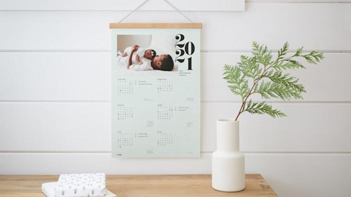 This hanging calendar can be customized with one of your favorite photos.