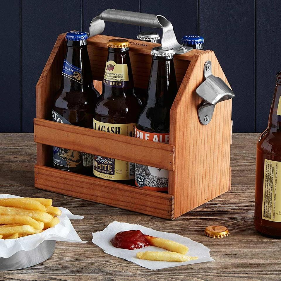 <p>This <span>beer tote</span> ($45) makes a six-pack of anything look classy. And it even has a bottle opener on the side - what more could you need? </p>