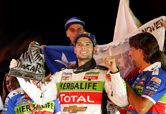 Dakar Rally - 2018 Peru-Bolivia-Argentina Dakar rally - 40th Dakar Edition - January 20, 2018. Ignacio Casale of Chile celebrates with the Dakar's trophy after winning in the quads category. REUTERS/Andres Stapff