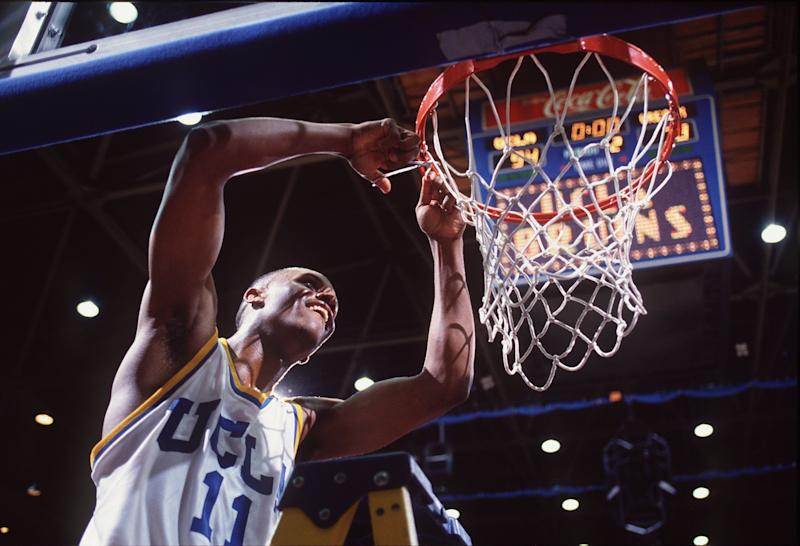 11 Mar 1995: UCLA GUARD TYUS EDNEY CUTS DOWN THE NET IN CELEBRATION OF THE BRUINS'' PAC-10 CHAMPIONSHIP AFTER A VICTORY OVER OREGON STATE AT PAULEY PAVILION IN LOS ANGELES, CALIFORNIA.
