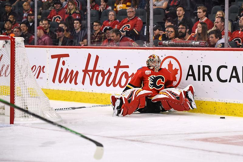 CALGARY, AB - OCTOBER 24: Calgary Flames Goalie David Rittich (33) stumbles behind his net while trying to play the puck during the second period of an NHL game where the Calgary Flames hosted the Florida Panthers on October 24, 2019, at the Scotiabank Saddledome in Calgary, AB. (Photo by Brett Holmes/Icon Sportswire via Getty Images)
