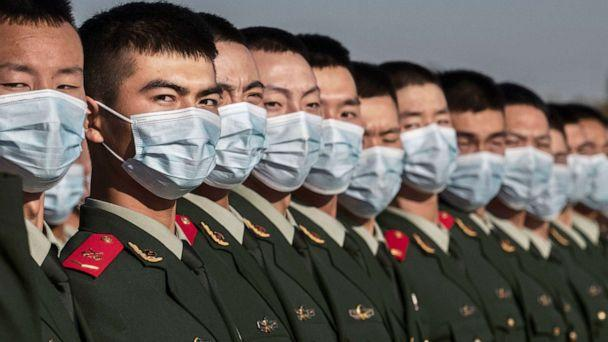 PHOTO: Chinese soldiers from the People's Liberation Army wear protective masks as they line-up after a ceremony marking the 70th anniversary of China's entry into the Korean War, on Oct. 23, 2020 in Tiananmen Square in Beijing.  (Kevin Frayer/Getty Images)