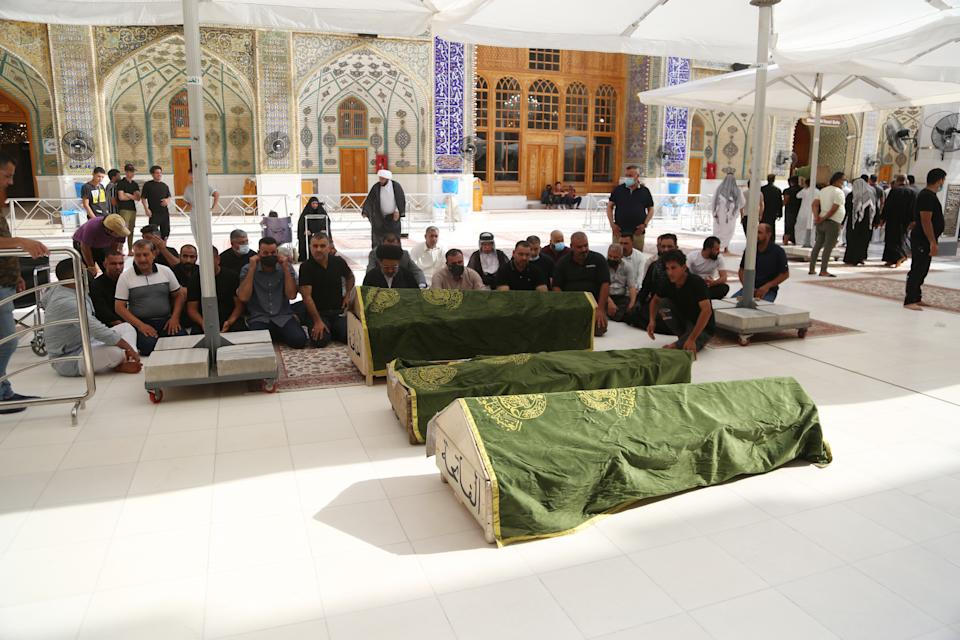 NAJAF, IRAQ - APRIL 25: Funeral ceremony held for 3 people who lost their lives at Baghdad Ibn al-Hatip Hospital fire, in Najaf, Iraq on April 25, 2021. More than 35 people died on Saturday in a fire at a hospital where coronavirus patients were being treated in Baghdad, said an Iraqi official. (Photo by Karar Essa/Anadolu Agency via Getty Images)