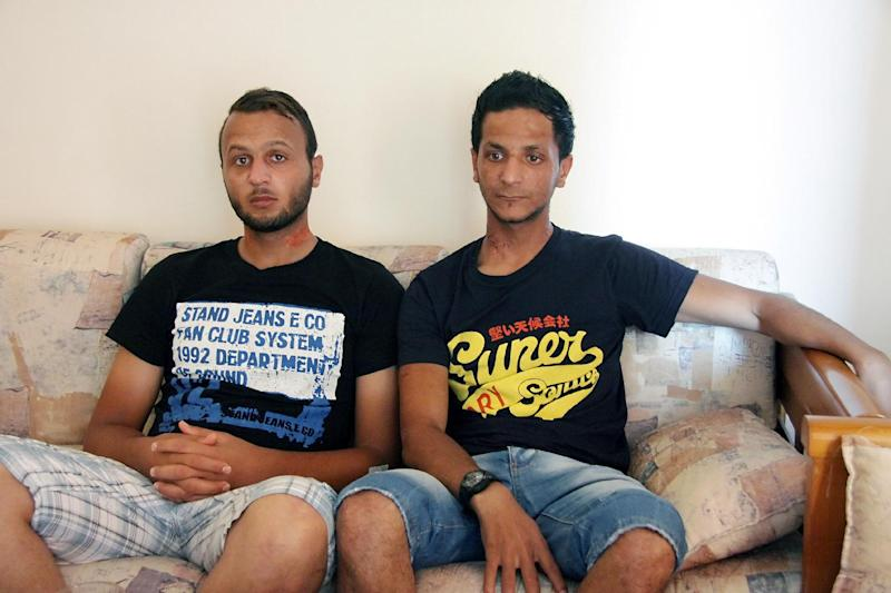 Mohamed Raad, a 23-year-old from Gaza (L) and Palestinian Abdelmazid Alhila, two of the ten survivors of Europe's deadliest migrant shipwreck, on the southern Greek island of Crete on September 17, 2014 (AFP Photo/Makis Kartsonakis)