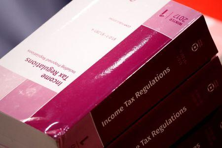 "Copies of tax legislation are seen during a markup on the ""Tax Cuts and Jobs Act"" on Capitol Hill in Washington"