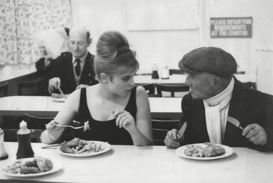 Actress Edina Ronay and her uncle Leny tuck into fish and chips in a shop in the Mile End Road, East London (28 April 1963) (George Elam/ANL/Shutterstock)