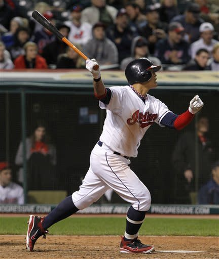 Cleveland Indians' Shin-Soo Choo, of South Korea, hits a fly ball to left against the Seattle Mariners during the seventh inning of a baseball game in Cleveland on Wednesday, May 16, 2012. (AP Photo/Amy Sancetta)