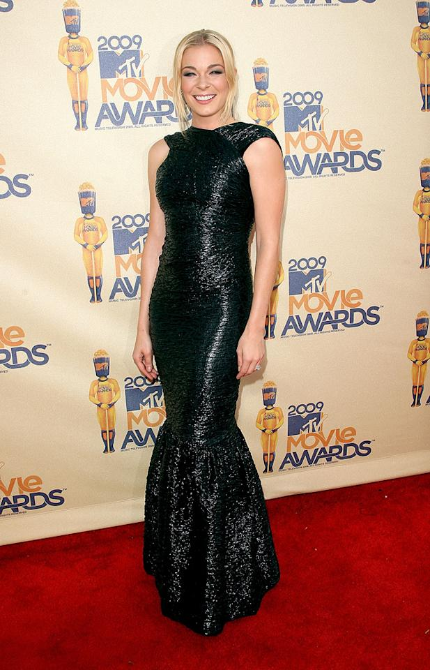 "<a href=""http://movies.yahoo.com/movie/contributor/1802271371"">LEANN RIMES</a>  Grade: C+  OK, there have been some sharp critiques of ladies who were too dressed down, but Leann went too far the other way. Her gown was black, long, shimmering, and way out of place."