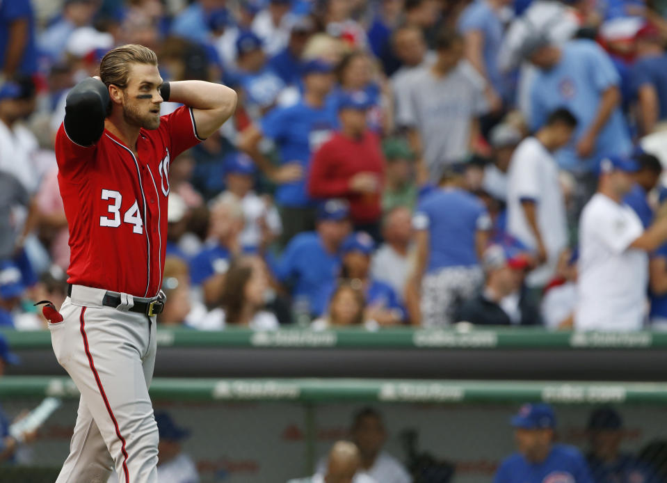 It doesn't sound like Bryce Harper is signing with the Cubs. (AP Photo)