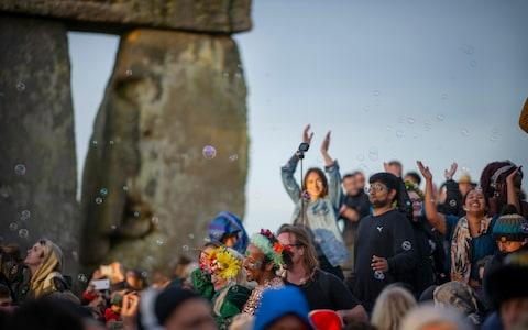 Revellers at the Summer Solstice Sunrise at Stonehenge, earlier today - Credit: Geoff Pugh for the Telegraph
