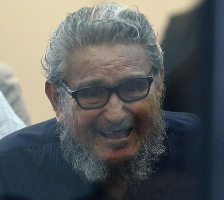 Former Shining Path leader Abimael Guzman attends trial at a high security naval prison in Lima