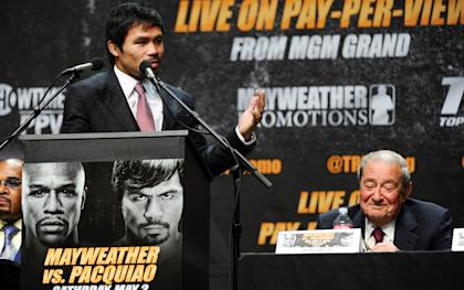 Manny Pacquiao thanks his promoter Bob Arum (right) during Wednesday's press conference. (USAT)