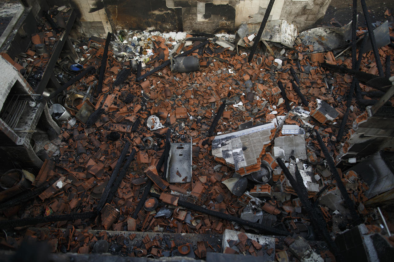 <p>A house is destroyed after a gas bottle exploded during a wildfire near Penacova on Oct. 17, 2017 in Coimbra region, Portugal. (Photo: Pablo Blazquez Dominguez/Getty Images) </p>