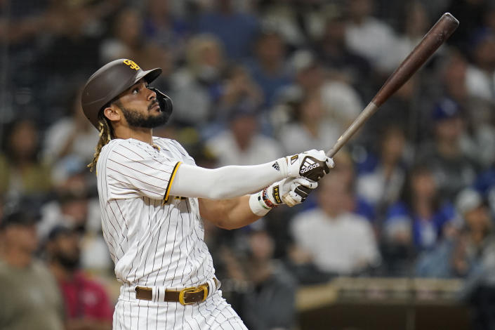 San Diego Padres' Fernando Tatis Jr. watches his two-run home run hit during the fifteenth inning of a baseball game against the Los Angeles Dodgers, Thursday, Aug. 26, 2021, in San Diego. (AP Photo/Gregory Bull)