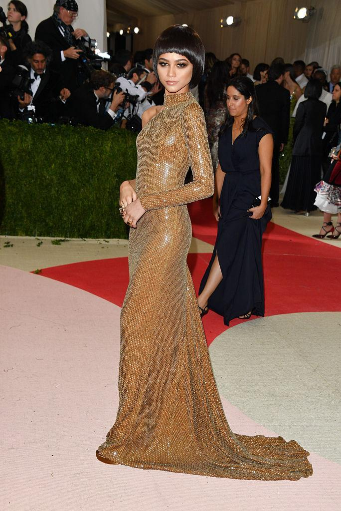 <p>Zendaya proved she's a pro when it comes to gracing the red carpet as she chose a gold gown by Michael Kors for the 2015 Met Gala. <em>[Photo: Getty]</em> </p>