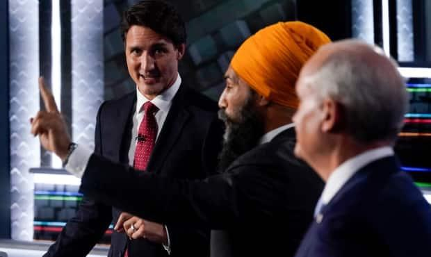 Left to right: Liberal Leader Justin Trudeau, NDP Leader Jagmeet Singh and Conservative Leader Erin O'Toole take part in the federal election English-language leaders debate in Gatineau, Que., on Thursday, Sept. 9, 2021. (Adrian Wyld/The Canadian Press - image credit)