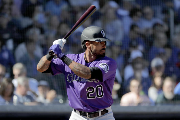 """Colorado Rockies' Ian Desmond during the first inning of a spring training baseball game against the Chicago Cubs, Tuesday, Feb. 25, 2020, in Mesa, Ariz. Desmond announced Sunday, Feb. 21, 2021 he is opting out for a second straight season. Desmond announced on his Instagram account that his """"desire to be with my family is greater than my desire to go back and play baseball under these circumstances. I'm going to train and watch how things unfold."""" He added """"for now"""" in his statement to opt out, leaving the door open for a possible return. (AP Photo/Matt York, file)"""