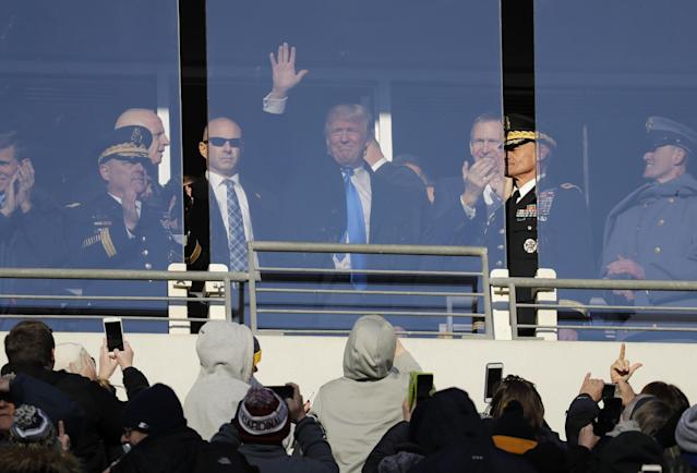 Donald Trump, then the president-elect at the time, acknowledges fans at the Army-Navy game in 2016. (AP)