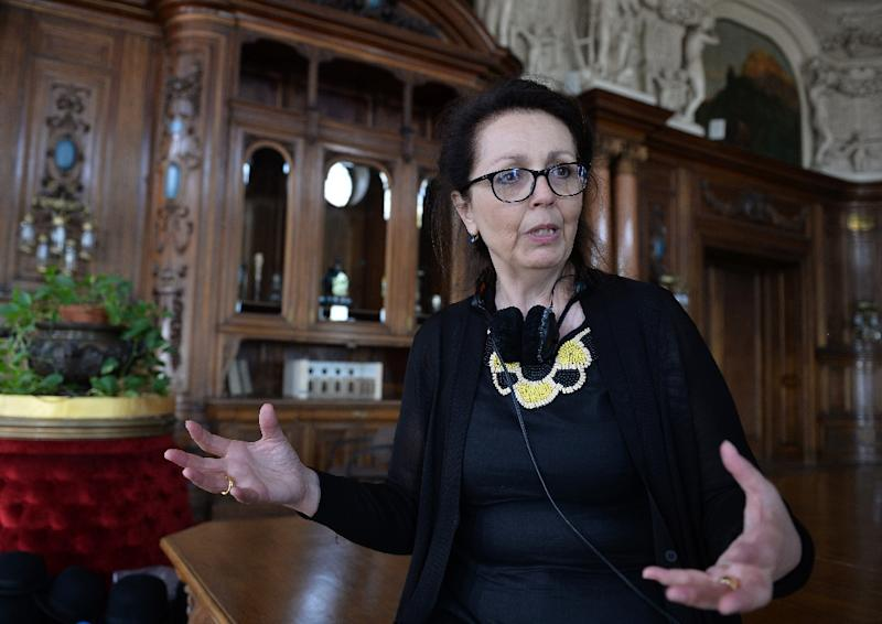 Director Marie Noelle talks to the press during the making of a movie about Maria Sklodowska-Curie in Poznanski Palace in Lodz, Poland on June 16, 2015 (AFP Photo/Janek Skarzynski)