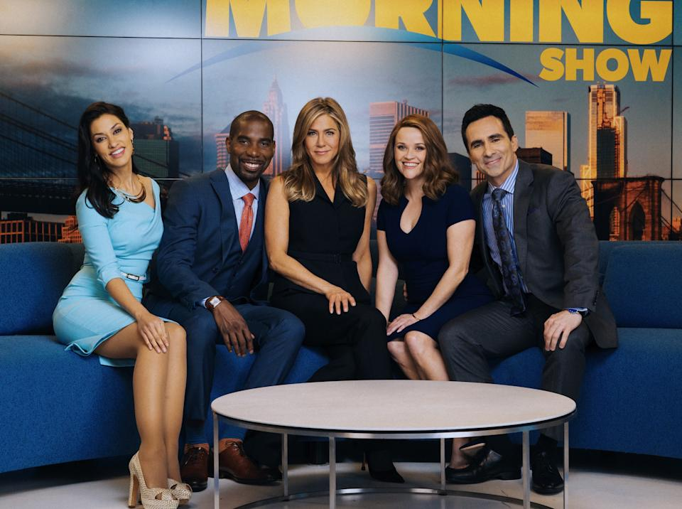 Janina Gavankar, left, poses with Desean Terry, Jennifer Aniston, Reese Witherspoon and Nestor Carbonell in