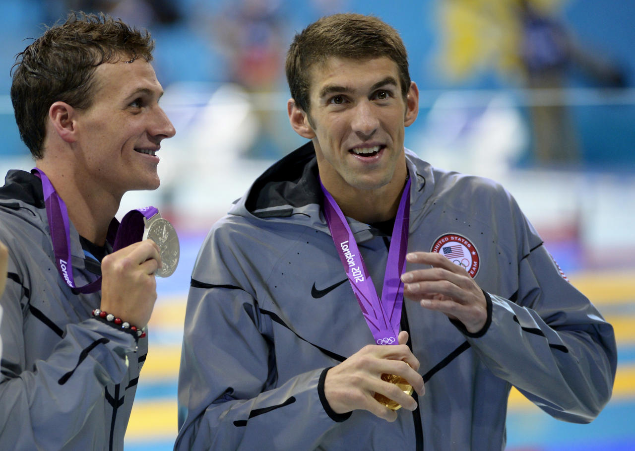 United States' Michael Phelps, right, and United States' Ryan Lochte pose with their medals for the men's 200-meter individual medley swimming final at the Aquatics Centre in the Olympic Park during the 2012 Summer Olympics in London, Thursday, Aug. 2, 2012. Phelps won gold, Lochte silver. (AP Photo/Mark J. Terrill)