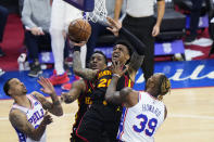 Atlanta Hawks' John Collins, center, is fouled by Philadelphia 76ers' Dwight Howard, right, during the second half of Game 7 in a second-round NBA basketball playoff series, Sunday, June 20, 2021, in Philadelphia. (AP Photo/Matt Slocum)
