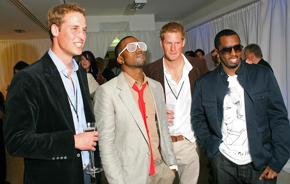 <p>In one of our favourite photographs to date, Princess Harry and William met music royalty at the Concert for Diana after party. Kanye West wore strikingly noughties glasses for the occasion while P Diddy chose a regal t-shirt. <em>[Photo: Getty]</em> </p>