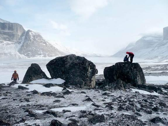 University at Buffalo students (left to right) Elizabeth Thomas, Sean McGrane and Nicolás Young study the historical extent of glaciers on Baffin Island.