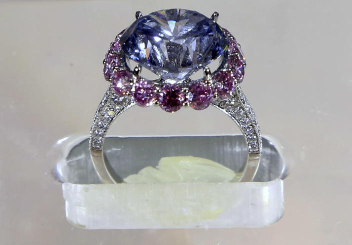 A 7.59-carat internally flawless blue diamond is on display Sotheby's, a New York auction house, Wednesday, Sept. 4, 2013 in New York. Sotheby's also had on display a 118-carat white diamond that will be auctioned in Hong Kong on Oct. 7 and has a pre-sale estimate of $28 million to $35 million. (AP Photo/Mary Altaffe)