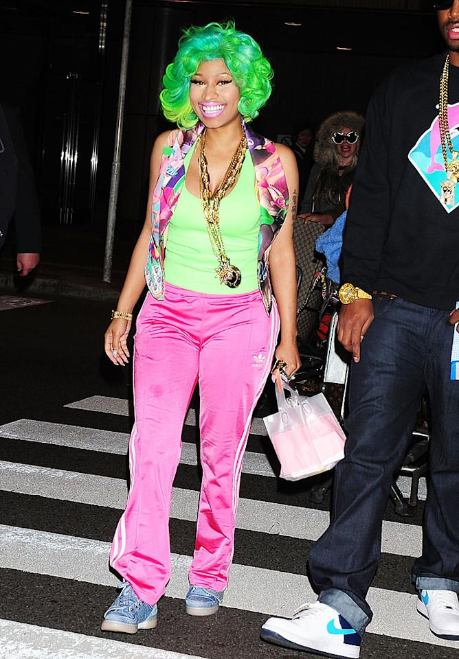 "Fellow music maker Nicki Minaj also turned heads this week when she hit the streets of Japan in a colorful outfit. While we love the ""Super Bass"" singer's fondness for loud hues and wild prints, we can no longer deal with her disastrous wigs. Hello? It's not like she can't afford top-of-the-line tresses! (3/20/2012)"