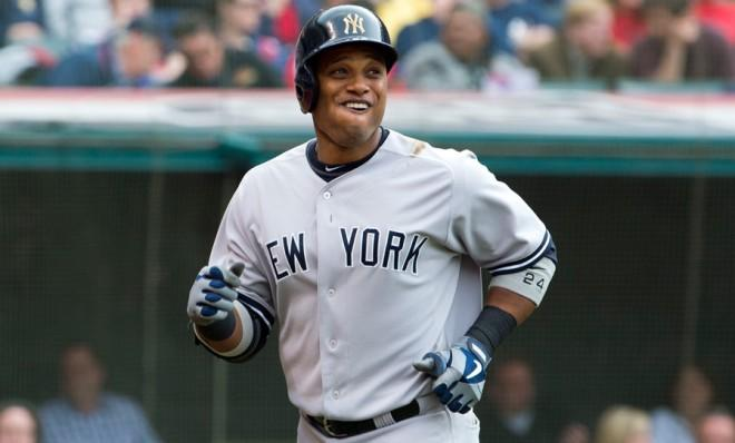 Robinson Cano smiles after slugging a solo home run against the Cleveland Indians on April 8.