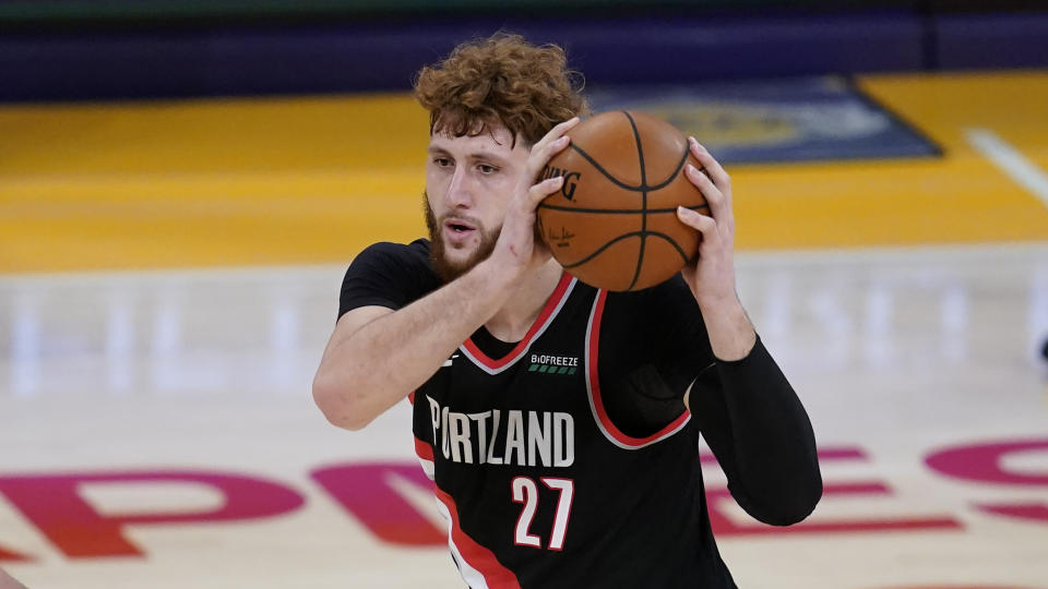 Portland Trail Blazers center Jusuf Nurkic (27) makes a pass during the fourth quarter of an NBA basketball game against the Los Angeles Lakers Monday, Dec 28, 2020, in Los Angeles. (AP Photo/Ashley Landis)