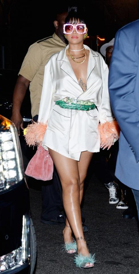 <p>Rihanna donned a silky shirt with lots of fluffy accessories.<br /><i>[Photo: Rex]</i> </p>