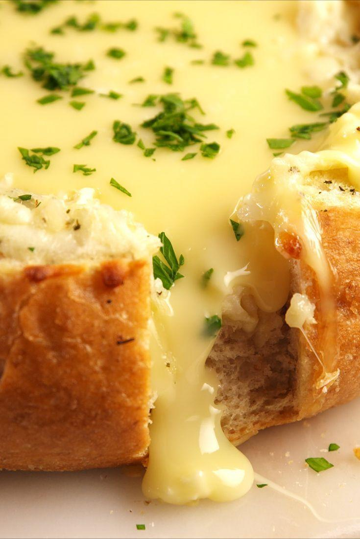 """<p>The best way to serve a crowd is to make a bloomin' brie bread. Inspired by the <a href=""""https://www.delish.com/uk/cooking/recipes/a30038149/baked-bloomin-onion-recipe/"""" rel=""""nofollow noopener"""" target=""""_blank"""" data-ylk=""""slk:bloomin' onion"""" class=""""link rapid-noclick-resp"""">bloomin' onion</a>, this bread is perfect for friends to dig into together. Tearing the bread and dipping in the melty cheese makes this the funnest (and tastiest) appetiser ever! </p><p>Get the <a href=""""https://www.delish.com/uk/cooking/recipes/a31219765/bloomin-brie-bread-recipe/"""" rel=""""nofollow noopener"""" target=""""_blank"""" data-ylk=""""slk:Bloomin' Brie Bread"""" class=""""link rapid-noclick-resp"""">Bloomin' Brie Bread</a> recipe.</p>"""