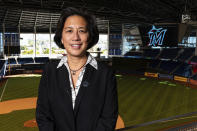 """In this Nov. 16, 2020, handout photo provided by the Miami Marlins, Marlins general manager Kim Ng is shown during a press conference at Marlins Park in Miami, Fla. Last fall, during her introductory news conference after years of beating her head against sports' glass ceiling, she said she felt as though a 10,000-pound weight had been transferred from one shoulder to the other. """"Failure is not an option for me,"""" Ng says. (Miami Marlins/Joseph Guzy via AP)"""