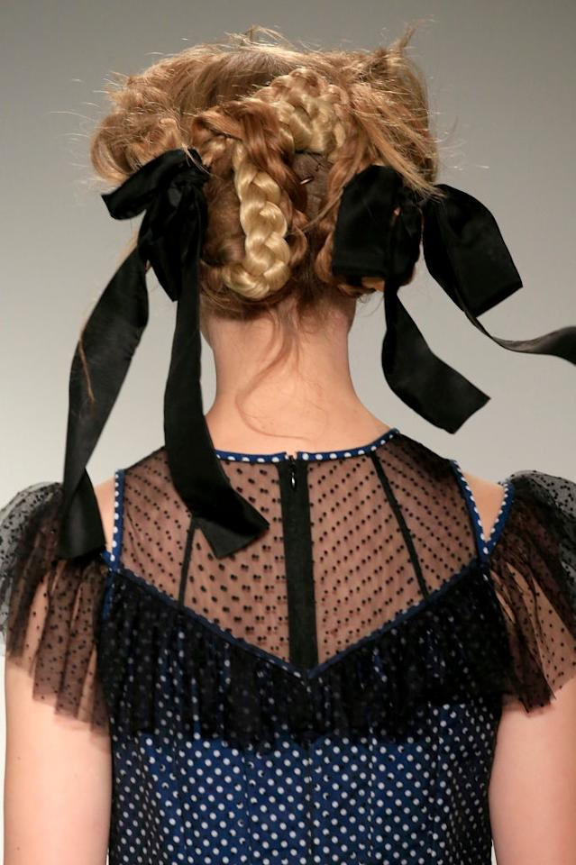 <p>Romantic hair is back, with intricate, girly braids & ribbons seen at Bora Aksu and Mother of Pearl.<br />[Photo: Getty] </p>