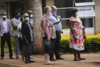 People wait in a queue to get a shot of the sinopharm coronavirus vaccination at Wilkins Hospital in Harare, Wednesday, March, 24, 2021. Zimbabwe is rolling out its COVID-19 inoculation programme and in the first phase is targeting health care workers and the elderly. (AP Photo/Tsvangirayi Mukwazhi)