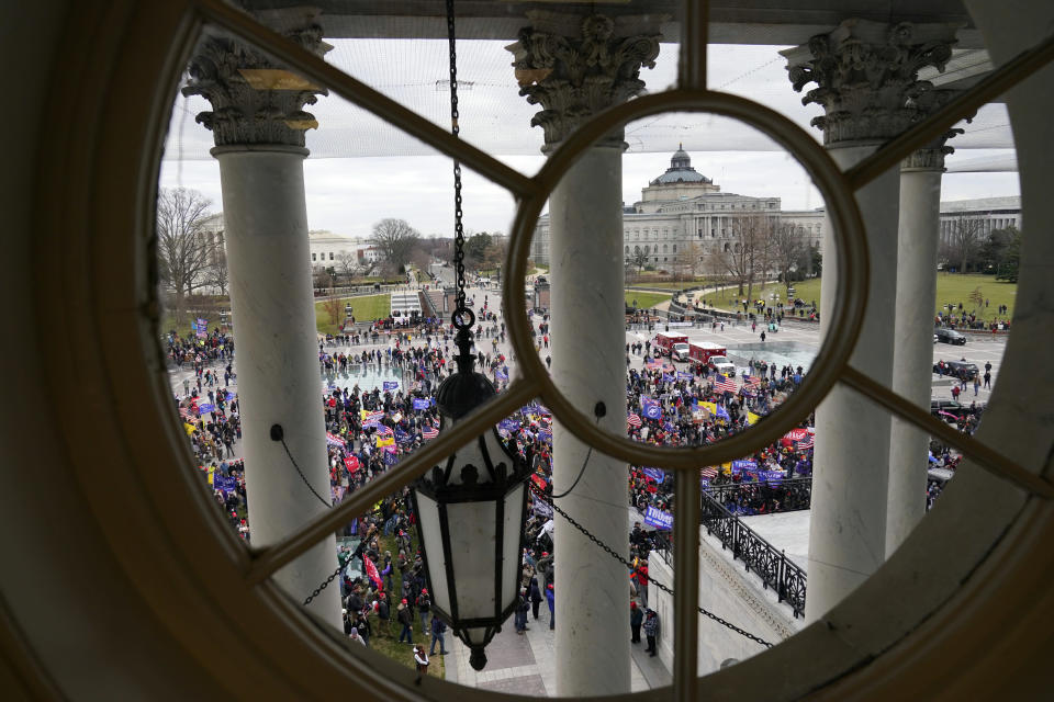 Violent protesters gather outside the U.S. Capitol, Wednesday, Jan 6, 2021. (AP Photo/Andrew Harnik)