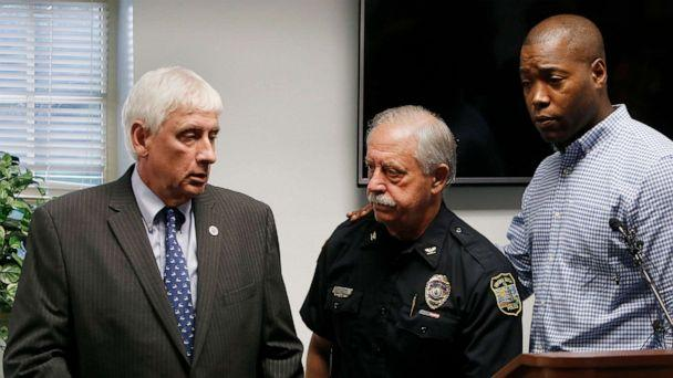 PHOTO: Virginia Beach Mayor Bobby Dyer, left, looks on as City Councilman Aaron Rouse, right, comforts Chief of Police James Cervera following a press conference, May 31, 2019 in Virginia Beach, Va. (Kaitlin Mckeown/The Virginian-Pilot via AP)