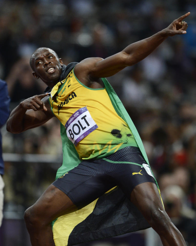Jamaica's Usain Bolt celebrates after winning the men's 100m final during the London 2012 Olympic Games at the Olympic Stadium August 5, 2012.  REUTERS/Dylan Martinez (BRITAIN  - Tags: OLYMPICS SPORT ATHLETICS TPX IMAGES OF THE DAY)