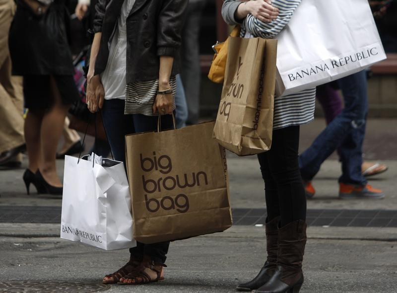 Shoppers carry their purchases along Broadway in New York City