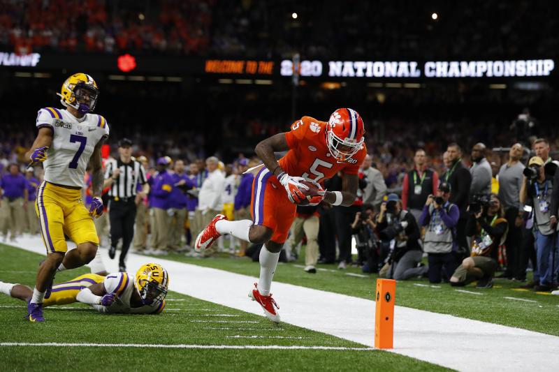NEW ORLEANS, LOUISIANA - JANUARY 13: Tee Higgins #5 of the Clemson Tigers dives to score a touchdown against the LSU Tigers during the second quarter in the College Football Playoff National Championship game at Mercedes Benz Superdome on January 13, 2020 in New Orleans, Louisiana. (Photo by Jonathan Bachman/Getty Images)