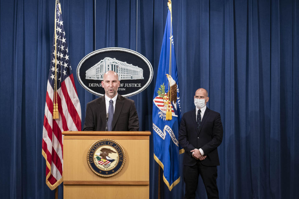 """Steven D'Antuono, head of the Federal Bureau of Investigation (FBI) Washington field office, speaks as acting U.S. Attorney Michael Sherwin, right, listens during a news conference Tuesday, Jan. 12, 2021, in Washington. Federal prosecutors are looking at bringing """"significant"""" cases involving possible sedition and conspiracy charges in last week's riot at the U.S. Capitol. (Sarah Silbiger/Pool via AP)"""