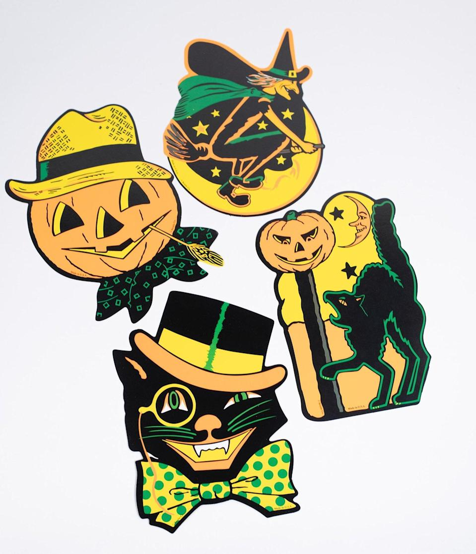 <p>Decorate your house with witches, cats, and jack-o'-lanterns with the <span>Vintage Style Halloween Paper Cutouts Decoration Set</span> ($14). </p>