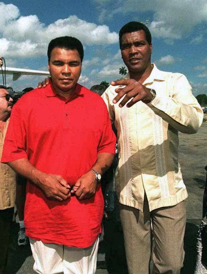 Former Cuban boxer Teofilo Stevenson (R), a three-time world amateur boxing champion, greets former world heavyweight champion US Muhammad Ali (L) on 18 January upon his arrival at the Jose Marti International Airport in Havana, Cuba. Stevenson --who won 301 of the 321 fights he took part-- died of a heart attack at the age of 60 in Havana on June 11, 2012.    AFP PHOTOPOOL/AFP/GettyImages