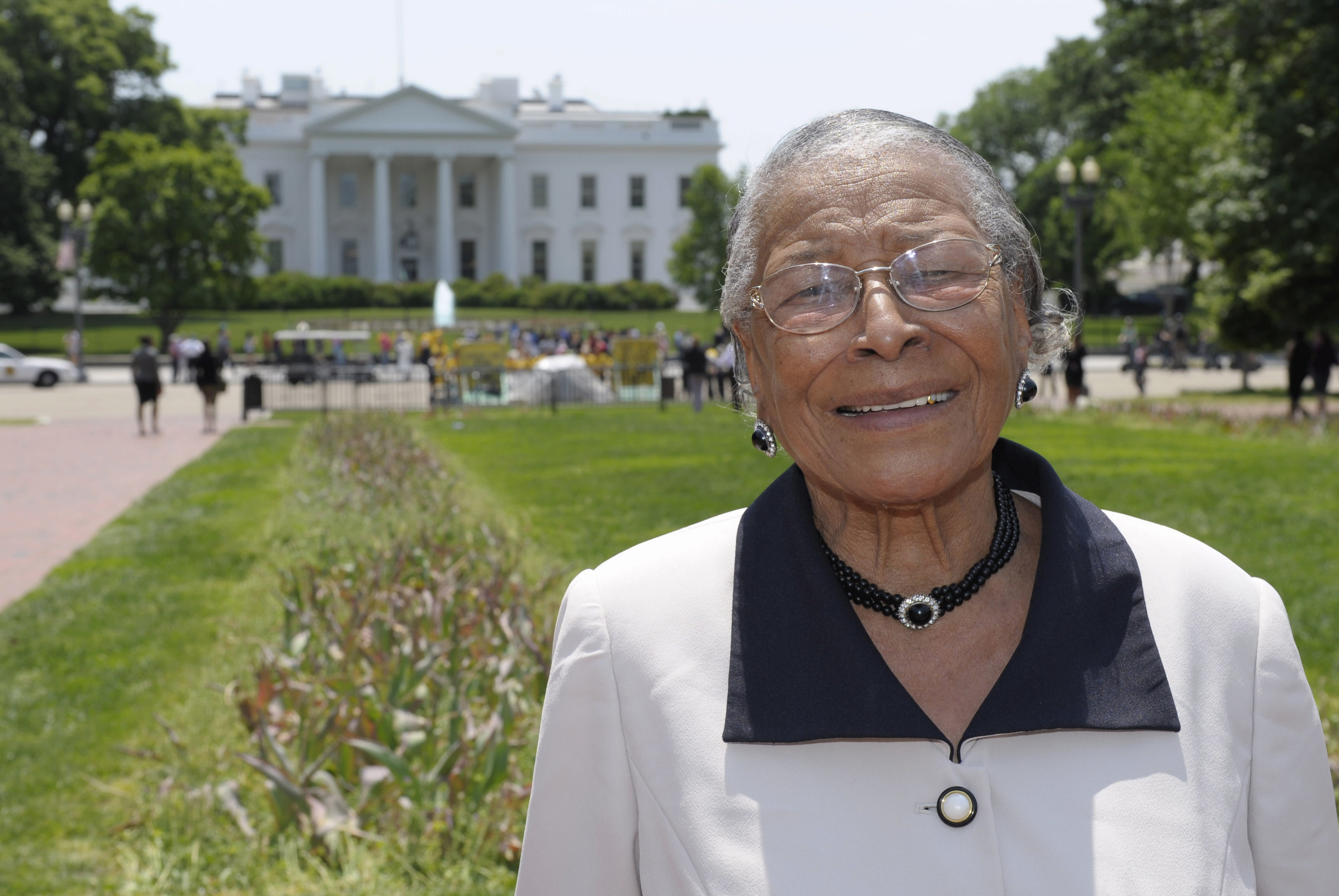 In this May 12, 2011 photo, Recy Taylor stands in Lafayette Park after touring the White House. Taylor, a black Alabama woman whose rape by six white men in 1944 drew national attention, died Dec. 28, 2017, according to her brother Robert Corbitt. She was 97. (Photo: AP/Susan Walsh, File)